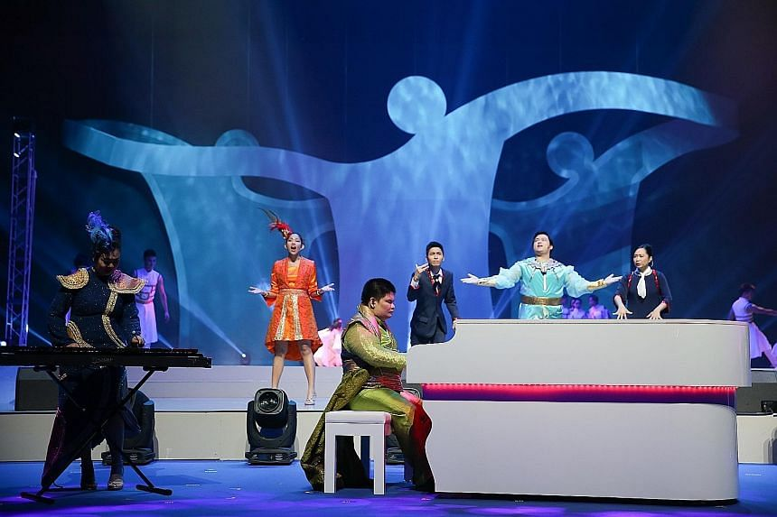 Above left: Last night's show, which featured more than 1,400 performers, who were able-bodied as well as disabled, was rich with the theme of inclusiveness and tolerance. Above right: Team Singapore marching in during last night's opening ceremony a