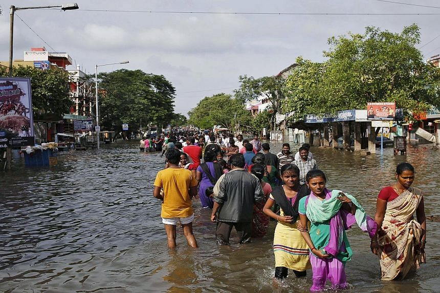 Severe flooding in Chennai has cut off basic services in the city and forced some residents to wade to evacuation areas. The navy has also had to use fishing boats to rescue people living in the worst-hit suburbs.