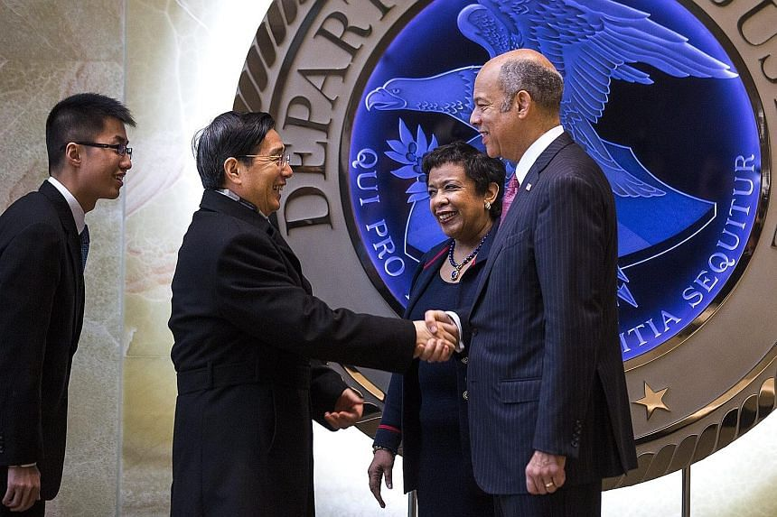 China's Minister for Public Security Guo Shengkun being welcomed by US Attorney- General Loretta Lynch and Homeland Security Secretary Jeh Johnson before their meeting on Wednesday.