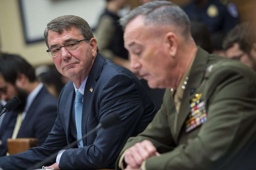 Carter (left) with General Joseph Dunford at an armed services committee hearing on Dec 2, 2015.