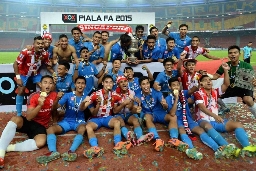 LionsXII players celebrating their victory after the Malaysia FA Cup final on May 23, 2015.