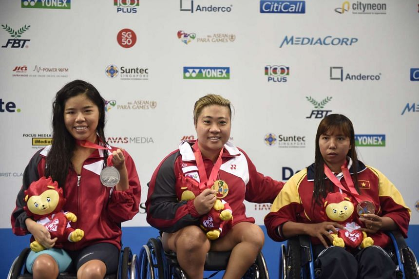 Gold medalist Theresa Goh of Singapore, her compatriot and silver medalist Yip Pin Xiu (left) and Danh Thi My Thnah of Vietnam (right) pose for photographs after receiving their medals for the 100m Freestyle S5 (S1-S5) Timed Final at the 8th ASEAN Para Ga