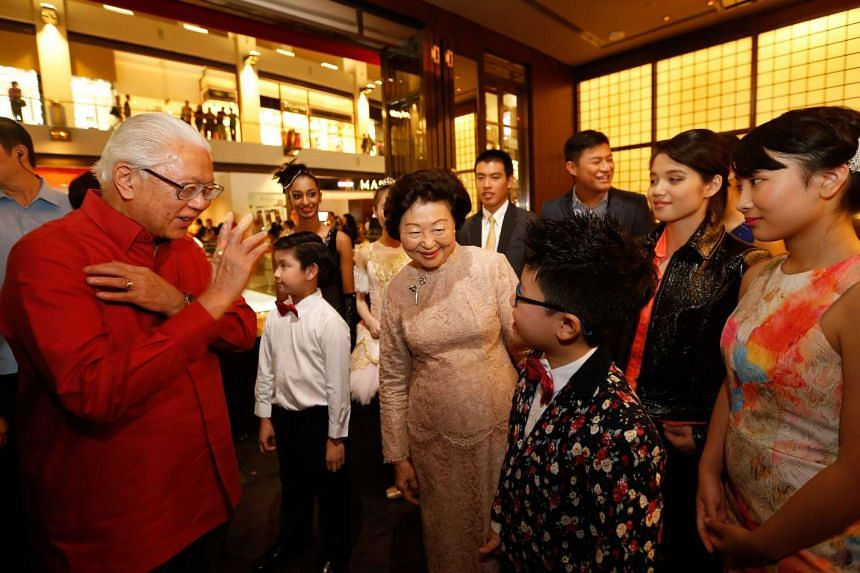 President Tony Tan (left) and wife Mary mingle with the ChildAid performers at the Marina Bay Sands.