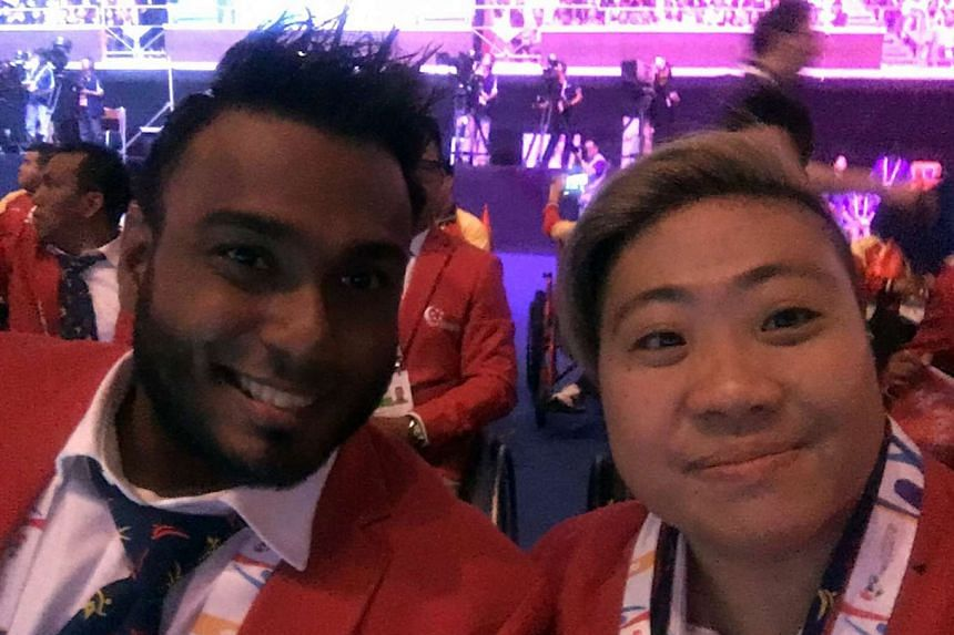 Swimmer Theresa Goh taking a wefie with wheelchair racer Muhammad Firdaus Nordin at last night's Opening Ceremony.