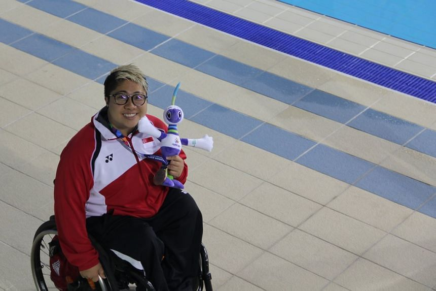Swimmer Theresa Goh is all smiles as with her bronze medal from the women's 100m freestyle S5 event at the 2014 Asian Para Games in Incheon, South Korea.