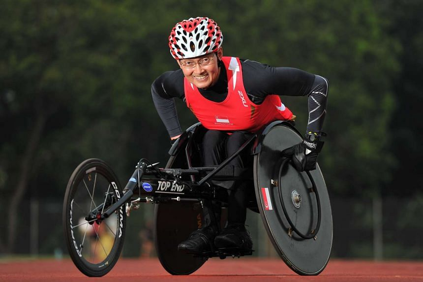 Dr William Tan, 58, a paralympian athlete, in his racing wheelchair.