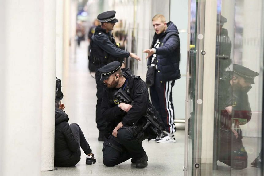 Armed police officers patrolling in St Pancras station, London, on Nov 17.