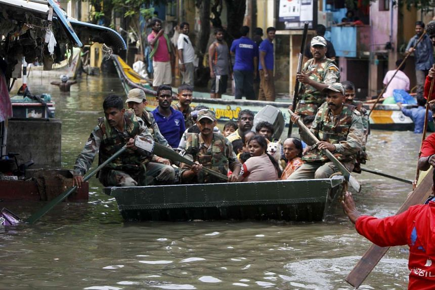 Indian army soldiers rescue flood affected people in Chennai.