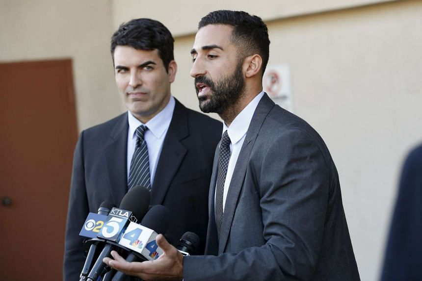 Lawyers representing the Farook family, David Chesley and Mohammad Abuershaid (right), speaking at a news conference in Los Angeles on Dec 4.