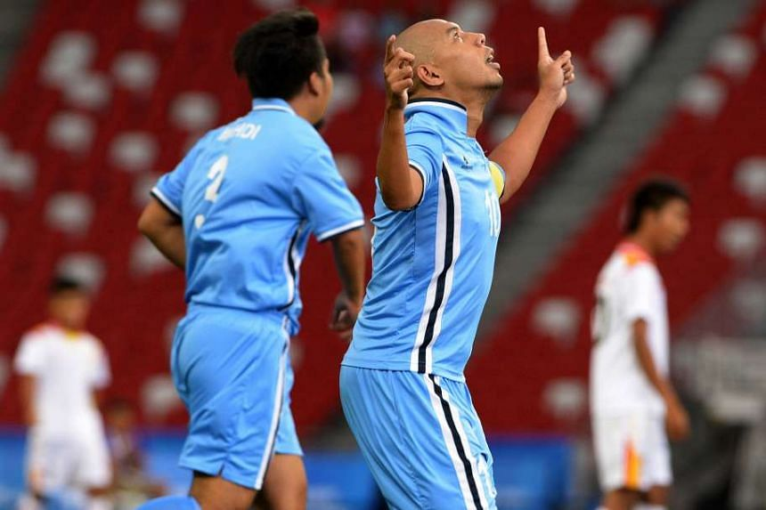 Singapore captain Khairul Anwar celebrating after netting his first goal.