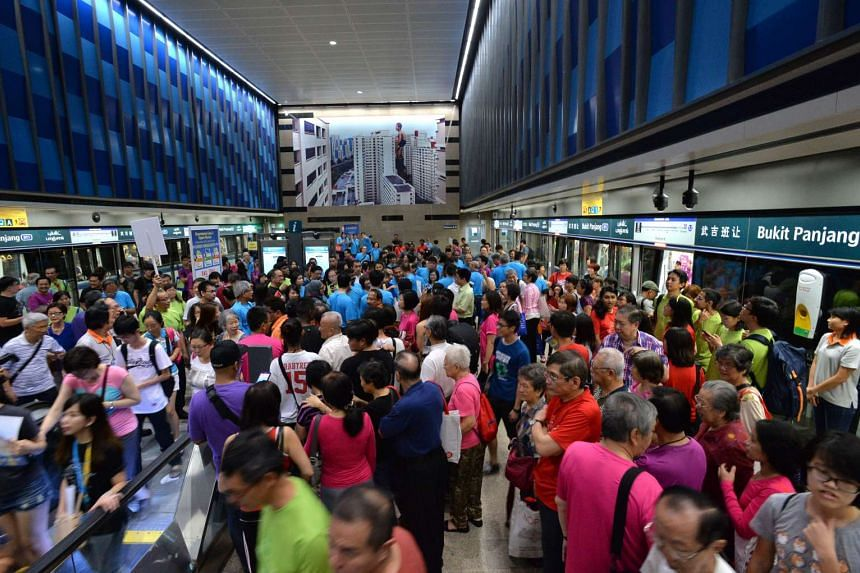 The Bukit Panjang station packed with commuters taking the opportunity to test ride the new Downtown Line.
