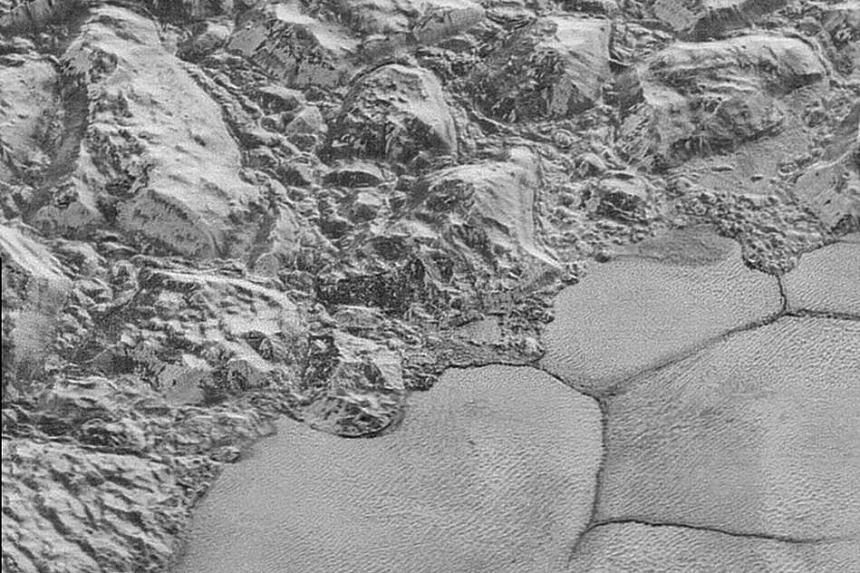 Great blocks of Pluto's water-ice crust appear jammed together in the informally named al-Idrisi mountains.