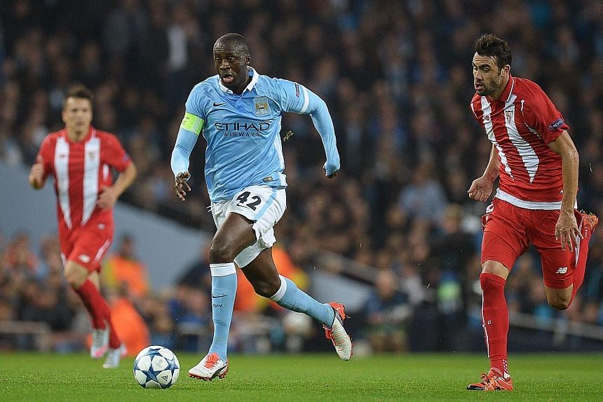 Yaya Toure in action against Sevilla in the Champions League. City will miss the Ivorian's presence in today's match against Stoke as he is sidelined with injury.