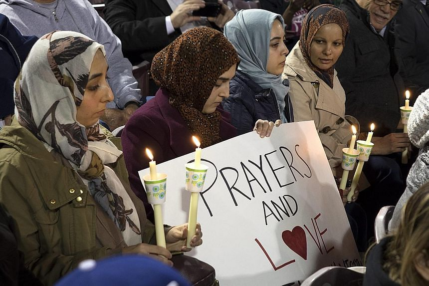Muslim mourners during a candlelight vigil for the mass shooting victims in San Bernardino, California. The massacre left 14 people dead and 21 wounded. The motives for the rampage remain unclear.