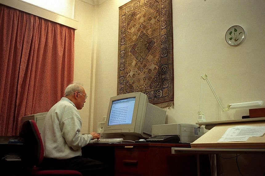 Mr Lee Kuan Yew knew about calls from the public to turn his house at 38, Oxley Road (above) into a museum and a memorial, but was adamant that it be demolished after his death. (Left) The late Mr Lee at work in the house.