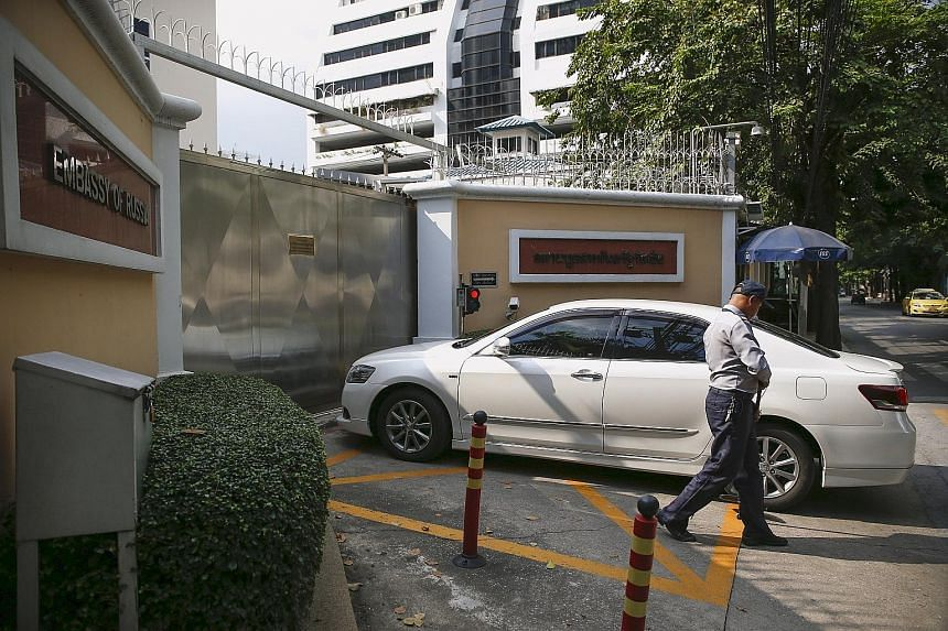 A security guard checking a car entering the Russian Embassy in Bangkok yesterday. The circular from Thailand's Special Branch to its offices said Moscow's Federal Security Service had told Thai police that 10 Syrian militants from ISIS had entered