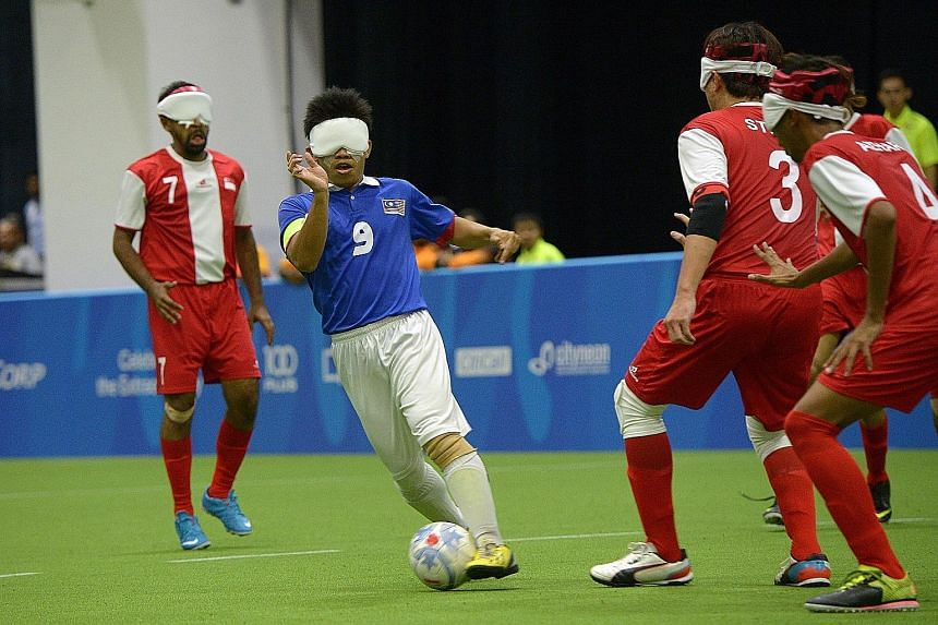 Mohd Azwan (No.9) dazzled in the game between Singapore and Malaysia, which drew a 900-strong crowd, including Prime Minister Lee Hsien Loong and Minister for Culture, Community and Youth Grace Fu.