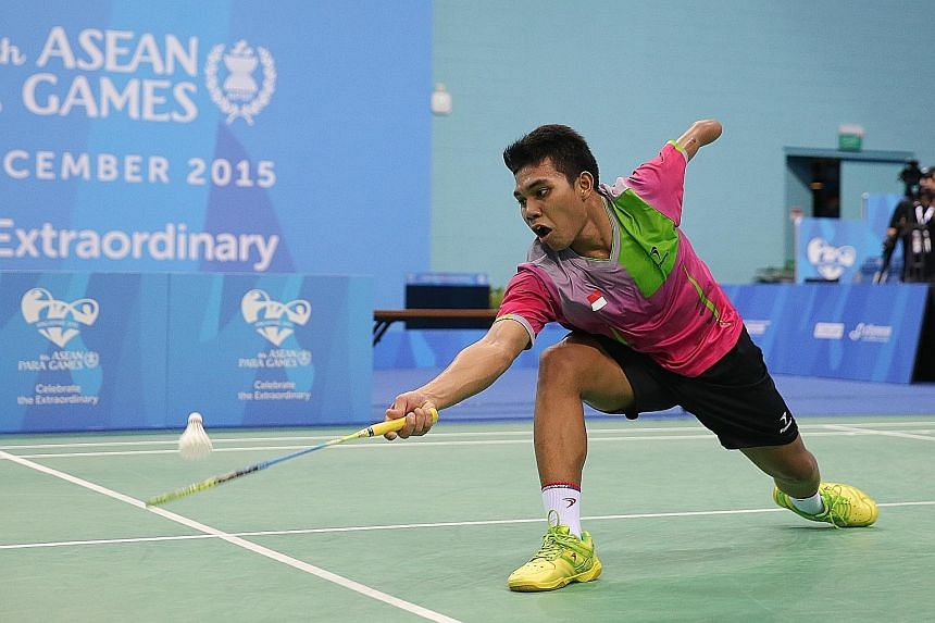 Indonesia's Suryo Nugroho (right) beat Malaysia's Mohamad Faris Ahmad Azri in the men's team badminton final yesterday. Having lost his left arm at 12, he went on to become his country's top para-shuttler.