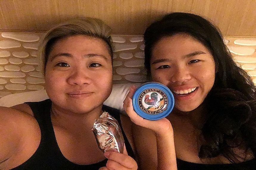 Para-swimmers Theresa Goh (left) and Yip Pin Xiu posing for a wefie.