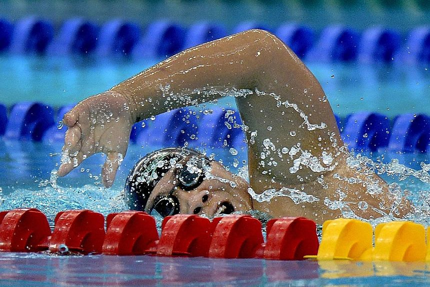 Theresa Goh wins Singapore's first gold at the Asean Para Games, finishing first in the 100m freestyle S5 (S1-S5) with a time of 1min 45.51sec.