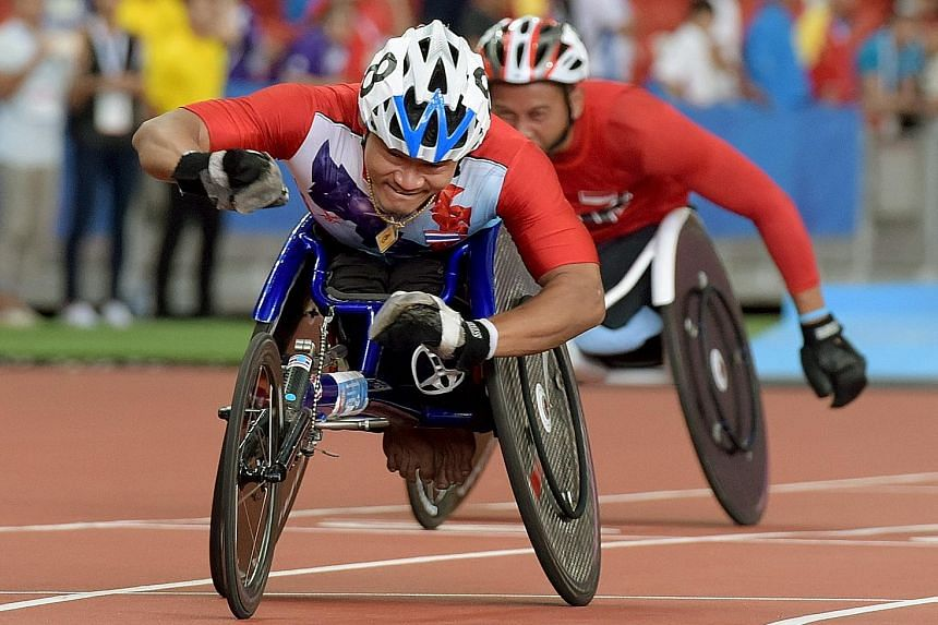 Thailand's Saichon Konjen winning the men's 100m T54 (wheelchair) final in a Games record time of 14.33sec. The 32-year-old is also the favourite to win the 200m and 400m races.