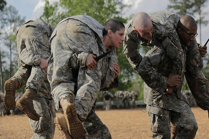 First Lieutenant Kirsten Griest and fellow soldiers in combat training during the Army Ranger course at Fort Benning, Georgia. Women have chafed under combat restrictions, which allowed them to serve in combat zones but prevented them from holding co