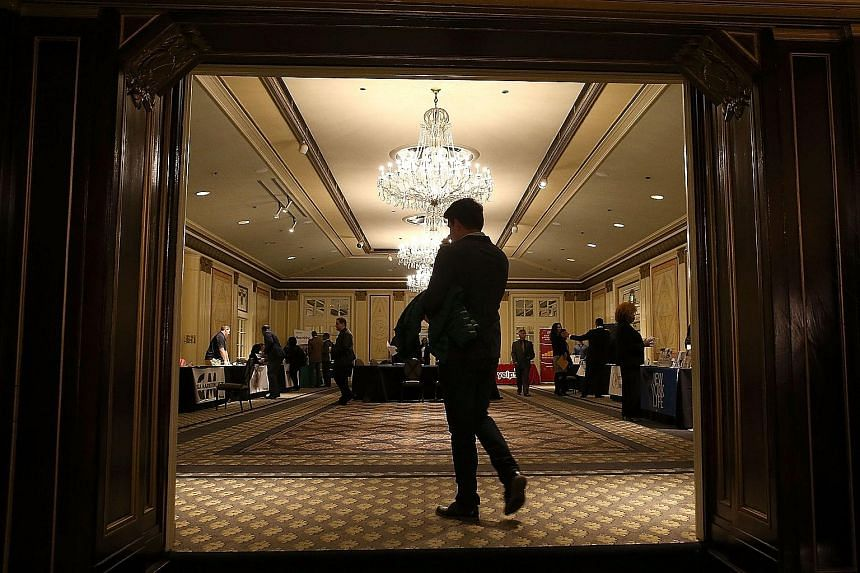 Job seekers at the HireLive Career Fair in San Francisco, California, last month. The 211,000 increase in the United States' payrolls followed a 298,000 gain in October that was bigger than previously estimated, a Labour Department report showed yest