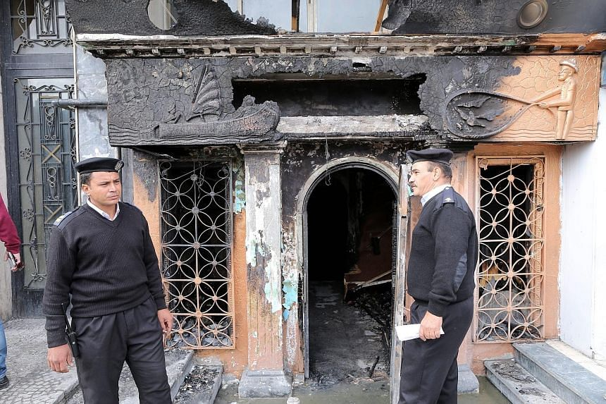 Security guards outside the El-Sayad club after the firebomb attack. Concerns about safety standards in Egypt, where dozens have died in blazes in recent years, are rising.