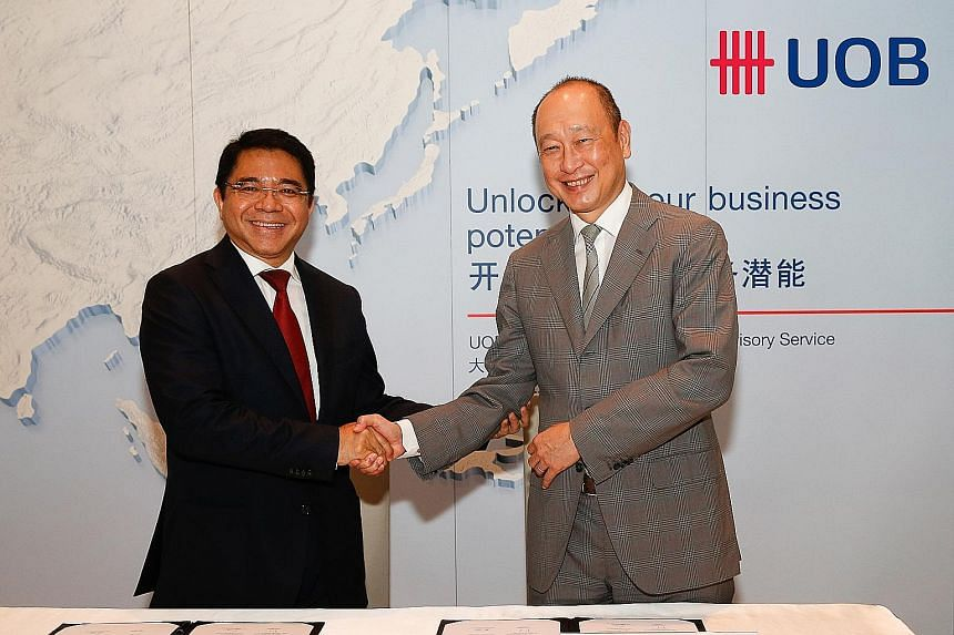 Mr Franky Sibarani (left), chairman of Indonesia's BKPM, with Mr Wee Ee Cheong, deputy chairman and chief executive officer of UOB. The two parties signed an agreement yesterday to boost investment in Indonesia.