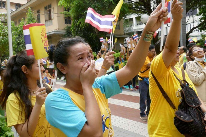 A Thai woman tears up outside a hospital in Bangkok on the 88th birthday of King Bhumibol Adulyadej on Dec 5, 2015.