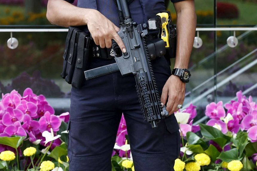 A police officer in Kuala Lumpur on Nov 20.