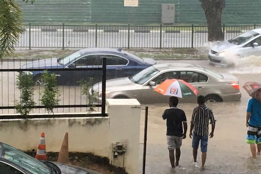 Cars stranded by flooding along Yio Chu Kang Road outside the Church of St Vincent de Paul.