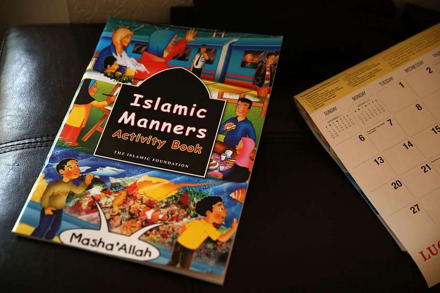 An Islamic Manners book sits in a bedroom.