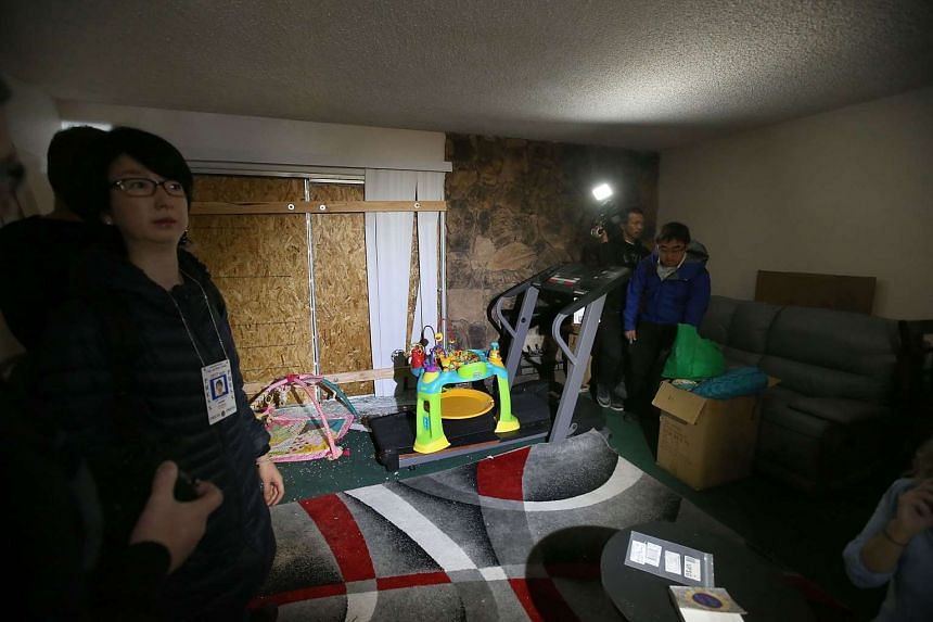 Reporters inspect the home of shooting suspect Syed Farook.