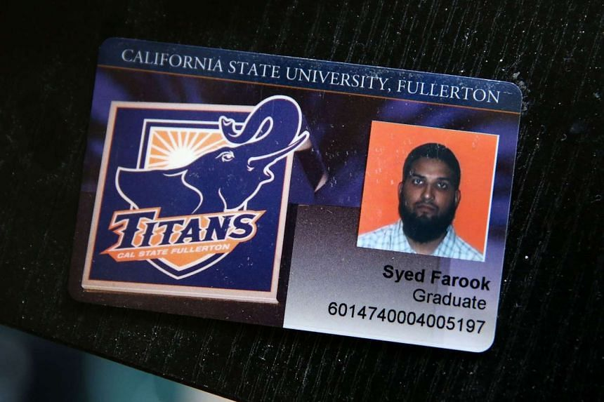 The California State University Fullerton student identification of Syed Farook sits on a desk.