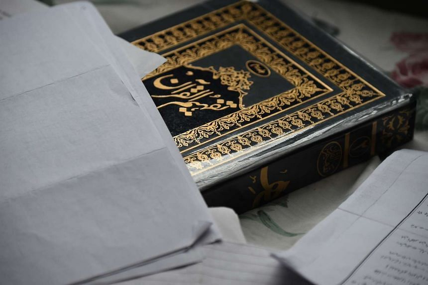 A book and documents are seen inside the home of shooting suspect Syed Farook.