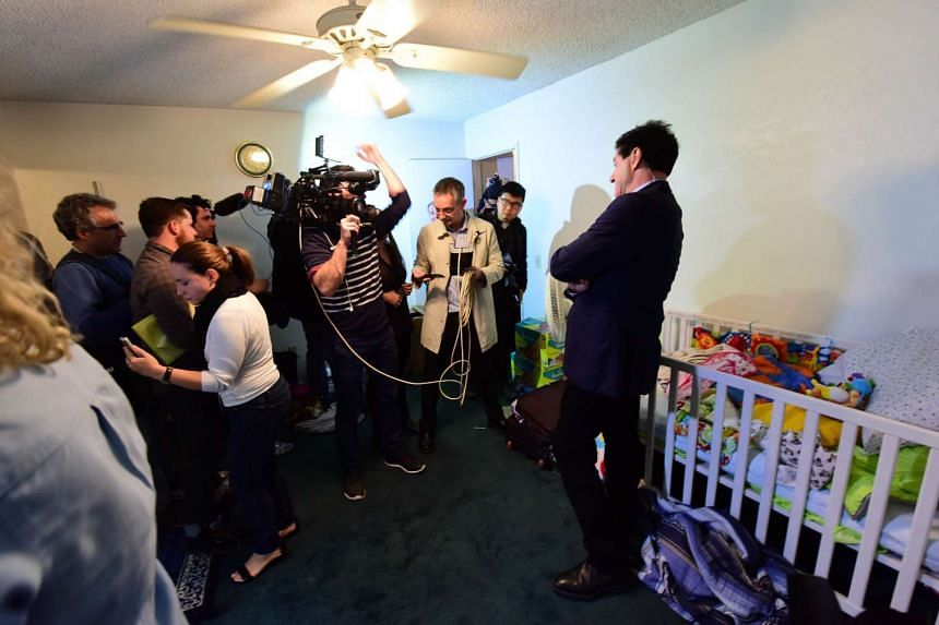 A television crew prepares to do a live report inside a child's bedroom.