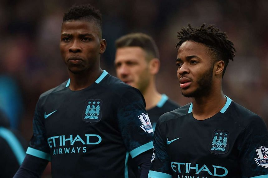 Manchester City striker Kelechi Iheanacho (left) and midfielder Raheem Sterling leave the pitch after losing.
