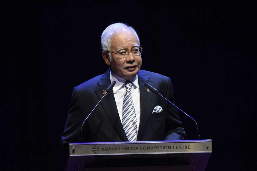 Malaysian PM Najib Razak speaking at the ASEAN Summit in Kuala Lumpur.