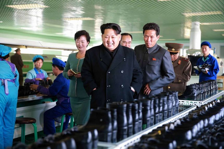 North Korean leader Kim Jong Un (centre) inspecting a shoe factory in Kangwon province.