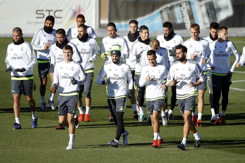 Real Madrid players warm up during their team's training session at Valdebebas sport city in Madrid.