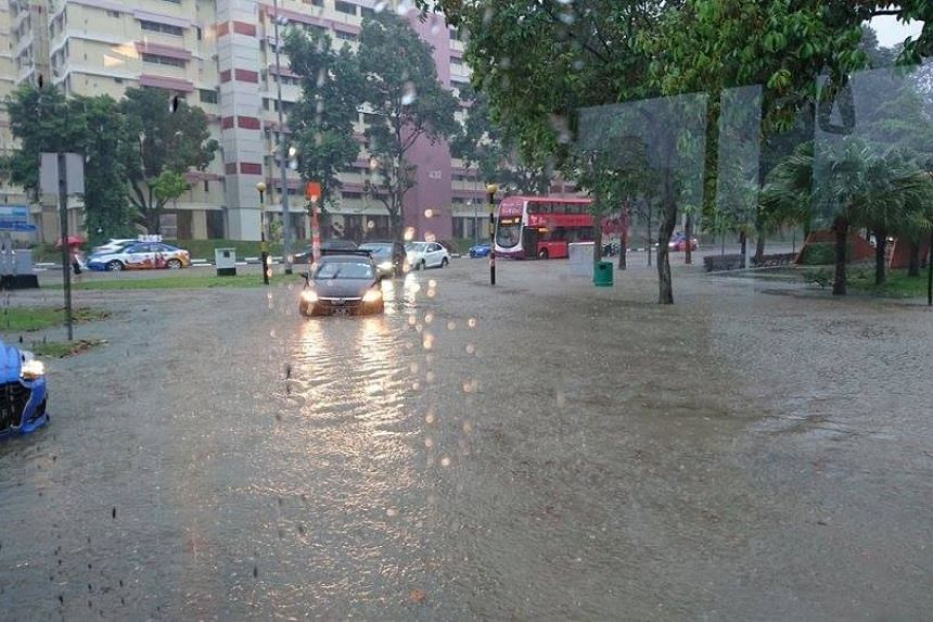Flooding at the junction between Hougang Avenue 8 and Hougang Avenue 6