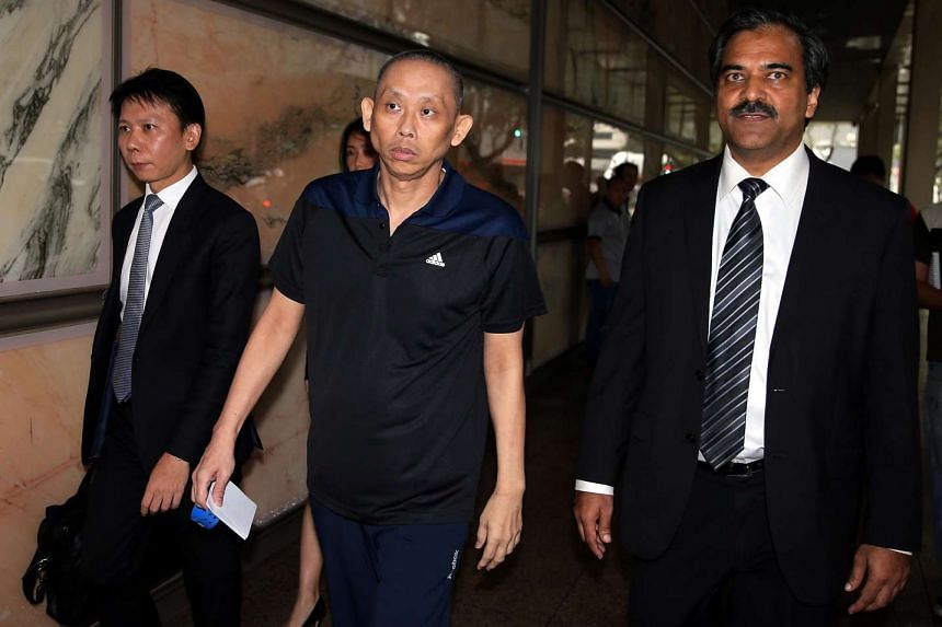 Dan Tan Seet Eng (centre) leaving the Supreme Court last month with lawyer Hamidul Haq (far right). Mr Haq said Tan is again being detained and investigated under the Criminal Law (Temporary Provisions) Act.