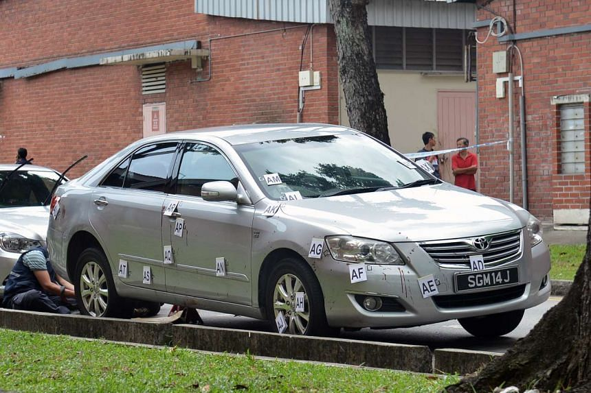 This silver Toyota Camry with the licence plate number SGM 14J was found abandoned at Eunos Avenue 7, with blood stains on the right headlight and the rear, on July 11, 2013. A day earlier, this car had dragged Mr Tan Chee Heong from his father's hom