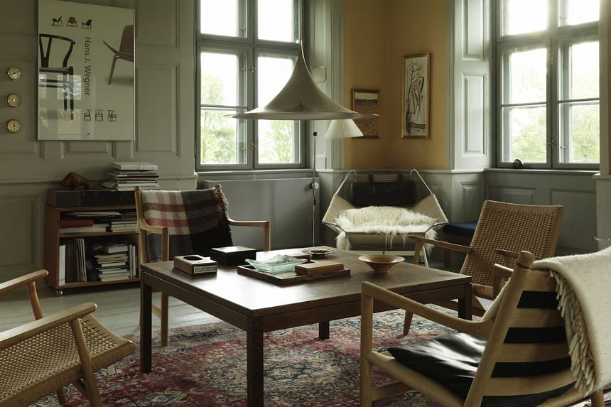 A living room in one of the wings of the Hellerup Estate owned by Knud Erik Hansen, managing director of Danish furniture company Carl Hansen & Son, in Denmark.