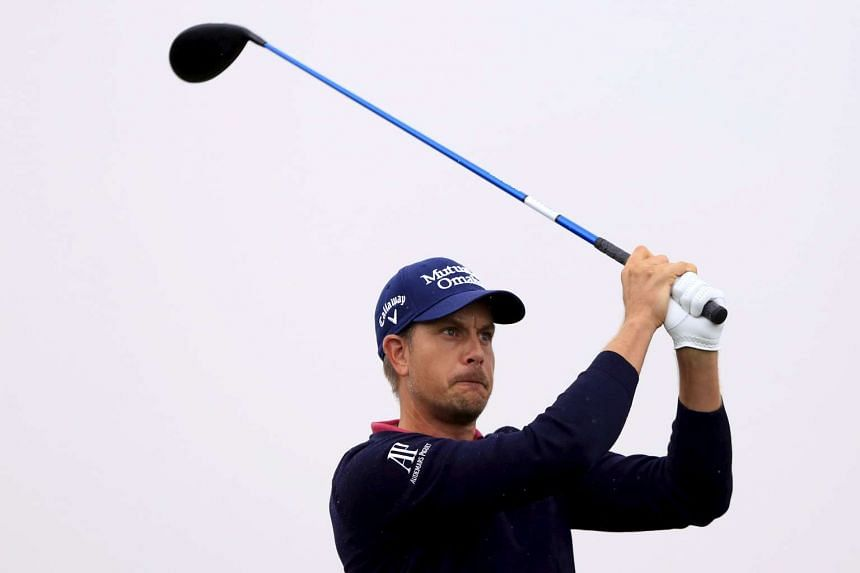 Henrik Stenson (above) has a one-shot lead at 11 under par.