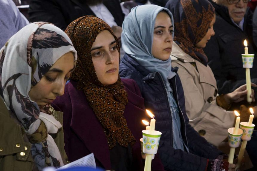 Muslim mourners at a candlelight vigil for the mass shooting victims in San Bernardino on Dec 3.