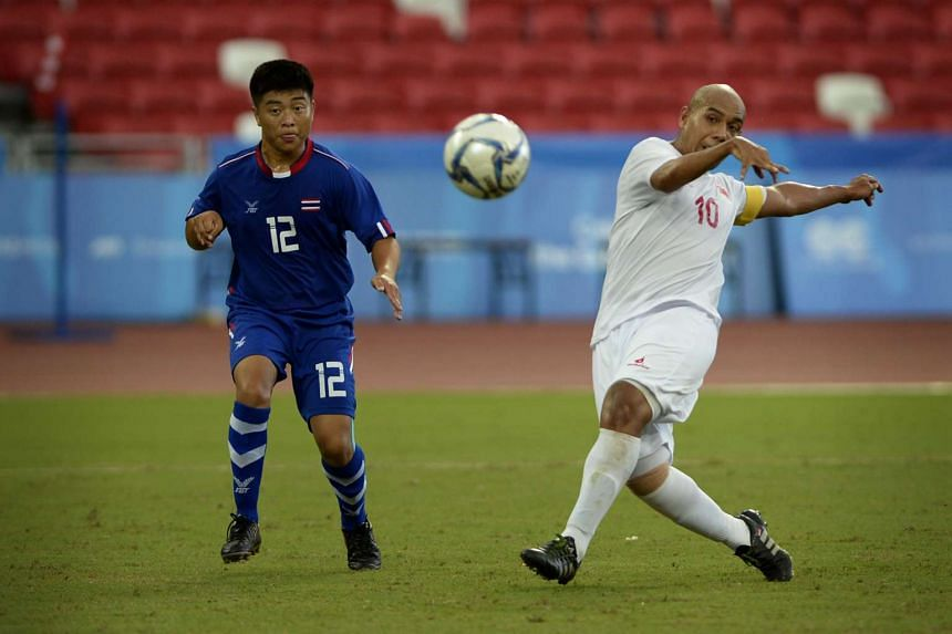 Khairul Anwar Kasmani of Singapore (right) in action against Wisan Tami of Thailand during their cerebral palsy football match on Dec 6, 2015.