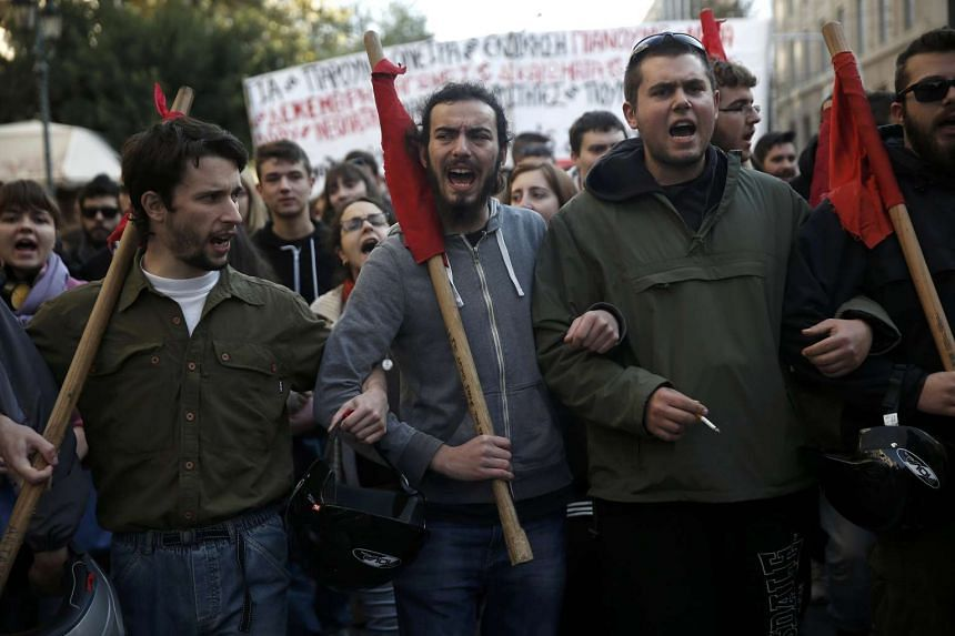 Protesters take part in an anniversary rally marking the 2008 police shooting of 15-year-old student, Alexandros Grigoropoulos, in Athens, Greece on Dec 6, 2015.