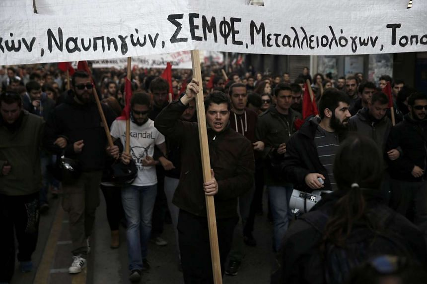 Protesters take part in an anniversary rally marking the 2008 shooting of a 15-year-old student in Athens.